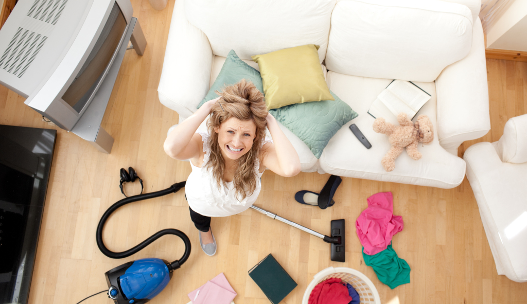 Frustrated Woman with Vacuum